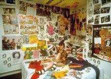 Liz Hall srounded by Sex Pistols memorabilia (circa 1979) © Phil Strongman